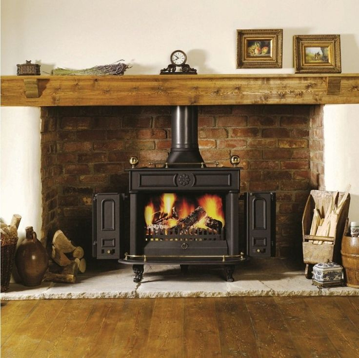 hearth ideas for free standing wood stove | ... Wood Burning Stoves Along With Brick Fireplace Insert And Wood Slab