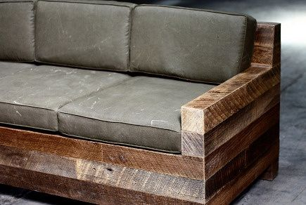 Rustic couch, made of four by fours - with denim covered cushions and some plaid flannel pillows, a quilt thrown over the back!!  Mid-century Modern couch