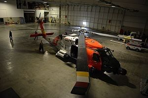 A Coast Guard MH-60 Jayhawk helicopter from Air Station Kodiak, Alaska, rests in the Deadhorse Aviation Center hangar in Prudhoe Bay, June 27, 2015. A Jayhawk crew is deployed to a forward operating location in support of Arctic Shield 2015. (U.S. Coast Guard photo by Petty Officer 1st Class Shawn Eggert)