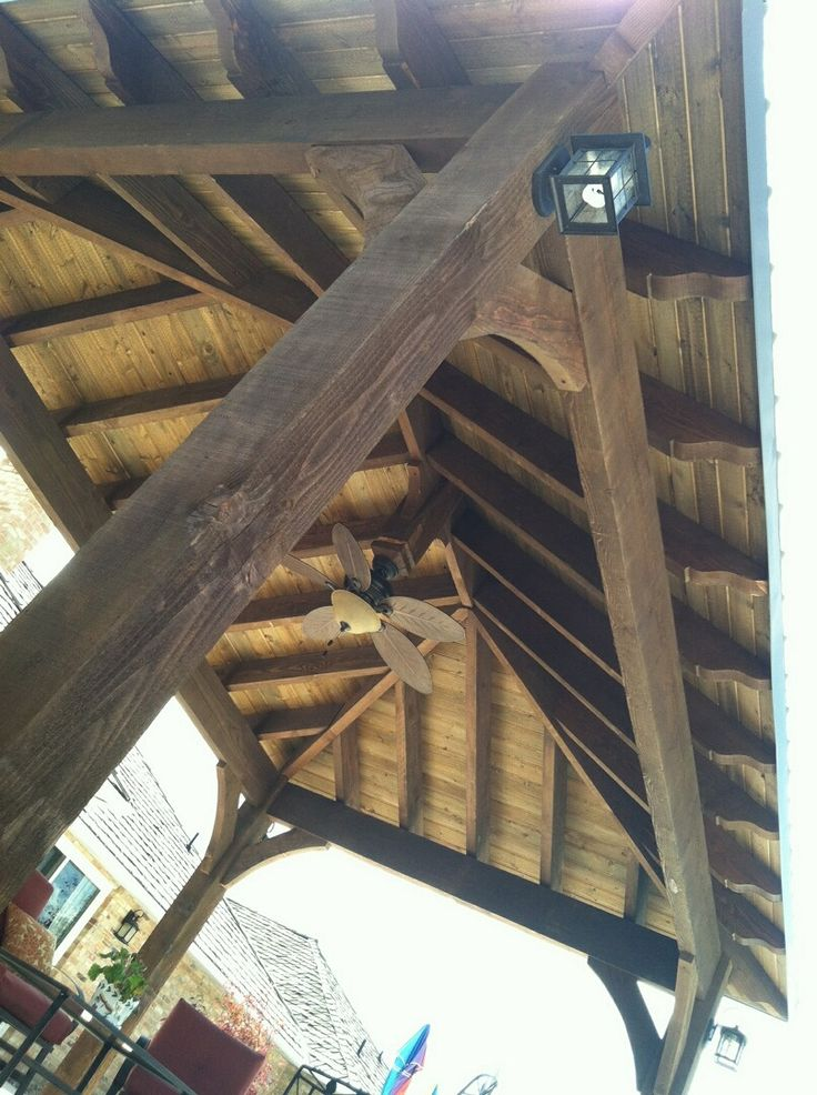 Covered pergola tongue and groove with a fan and lights