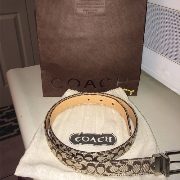 Authentic Coach Reversible C Sig and Tan Belt Beautiful Coach Reversible C Signature and Natural Belt with dustbag included. Purchased at Coach Store in Princeton, NJ. Wore a few times but still in great condition!!! Thanks for looking!! Coach Accessories Belts