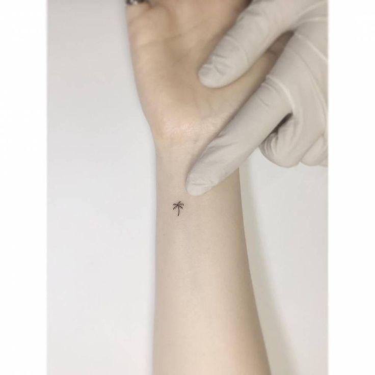 Tiny Palm Tree Tattoo On The Inner Wrist.