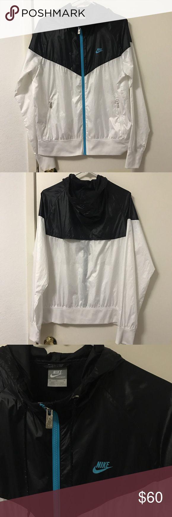 Nike windrunner jacket Vintage Nike windrunner jacket / Black and white with blue detailing /  Size medium / tiny flaws: a bit dirty on the inside hem / #nike #nikejacket #windbreaker #windrunner #sportswear Nike Jackets & Coats Windbreakers