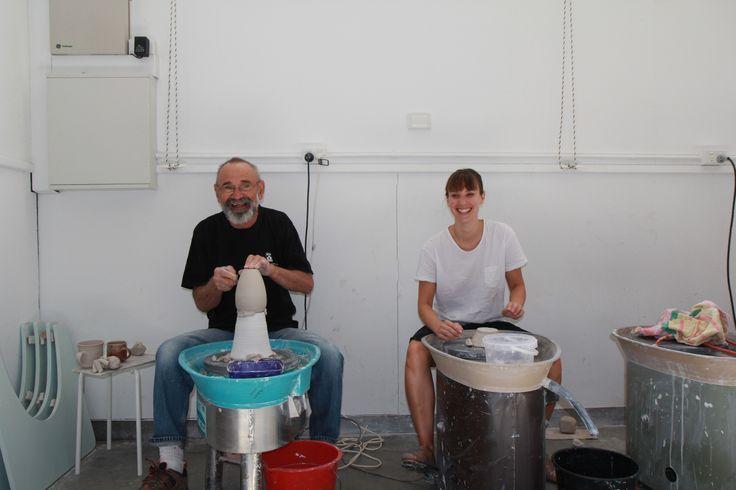 Ceramics tutor Stewart Scambler with a student in our ceramics studio