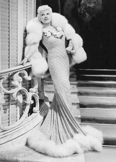 Mae West Introduces Americans to—Gasp!—Sex. She was a tiny lady, barely five foot tall. It was more than her trademark Gay '90's plumed hats that made her seem much bigger. It was a bold, brassy, and irreverent persona that challenged everything puritanical America valued in submissive, virtuous, sexless, and dependent womanhood.