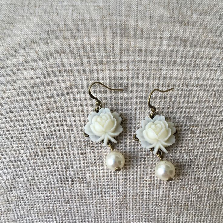 A personal favorite from my Etsy shop https://www.etsy.com/listing/234512566/bronze-drop-earrings-with-pretty-ivory