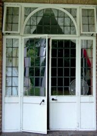 French doors with leaded panes and overlights including arch detail