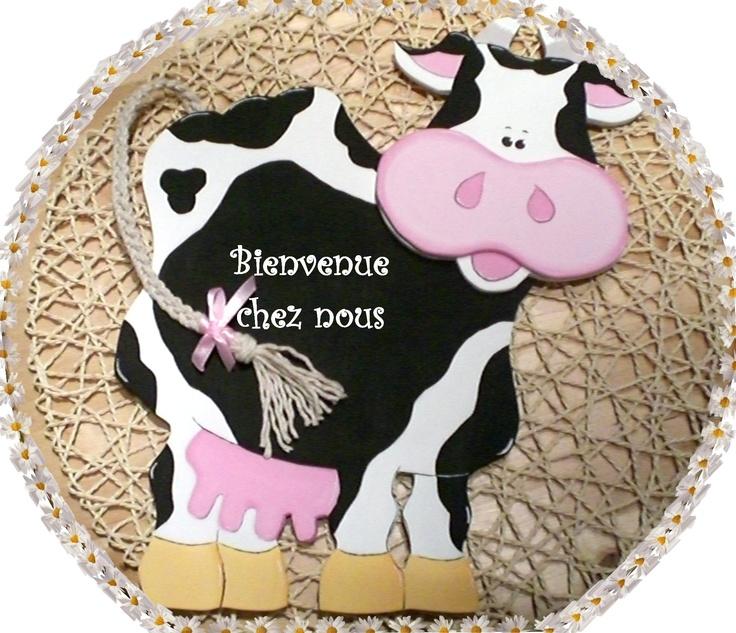 vache faite en bois à la scie manuelle