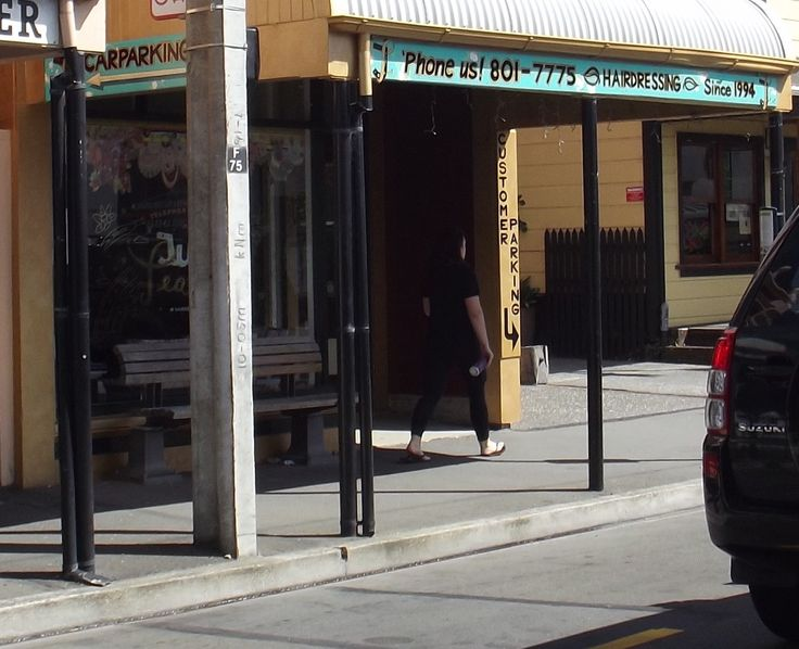 "More signage for ""Just Teasing"" Hairdressing, 247 Willis st, Wellington. Paint metallic gold around shop frontage. Make & attach, 141cm x 36cm outside of sth end beam, 427cm x 25cm street side of awning, & 176cm x 25cm street facing side nth pillar, signs. 7/2/16"