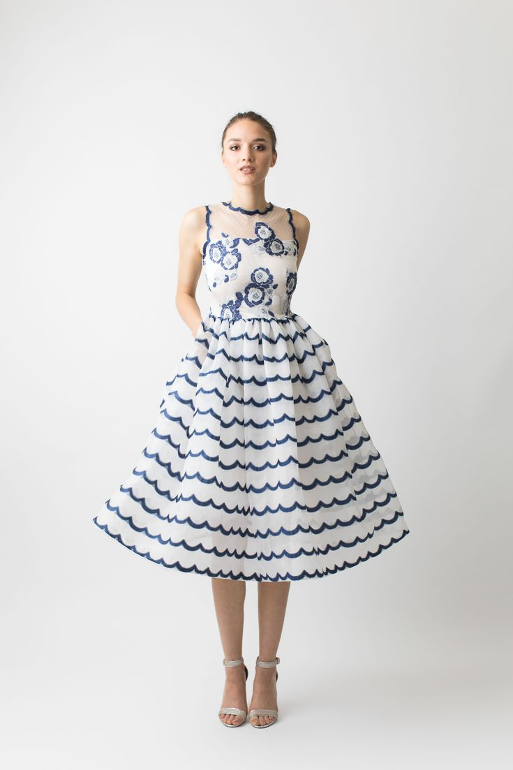 Sleeveless organza striped blue and white cocktail dress. Narces creates a simply charming sleeveless blue and white coctail dress with an illusion neckline, featuring a flared skirt that also has side seam pockets. A crinoline is worn undereneath the skirt to give it its voluminous shape. The bodice has blue and white flowers while the skirt has scalloped stripes running horizontally accross giving it a gorgeous contrast. Perfect for garden or cocktail parties. #cocktail #evening #lace…