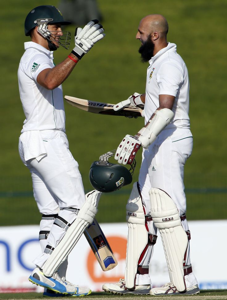 Faf du Plessis and Hashim Amla embrace after Amla reaches a 20th Test century, Pakistan v South Africa, 1st Test, Abu Dhabi, 1st day, October 14, 2013 ©AFP