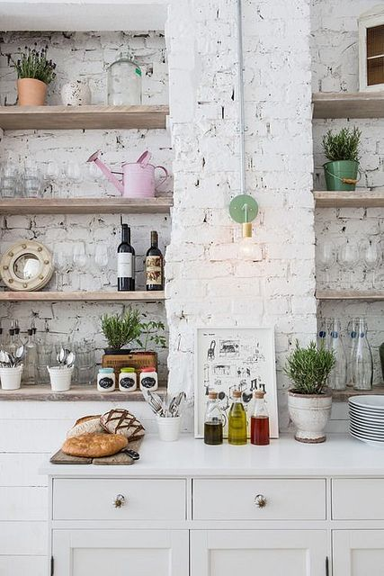 white + brick + shelving