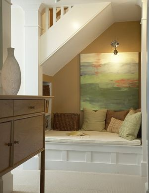 under stair bench seat nook with light, shelves, drawers
