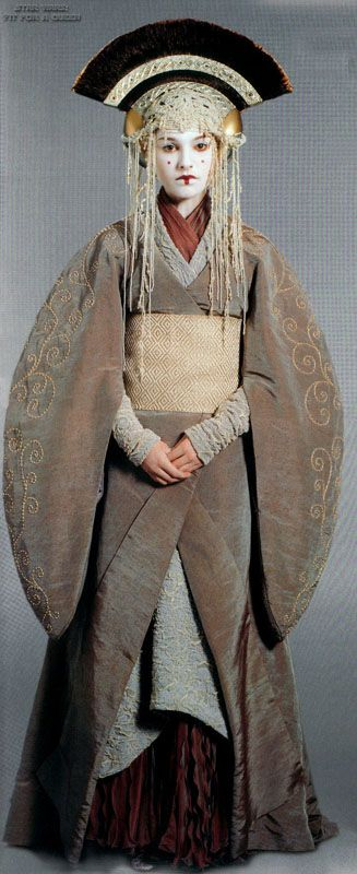 Padme/Queen Amidala's costumes for Star Wars Episode 1: The Phantom Menace. Note: While in the film the second dress is actually worn not by Amidala but her handmaiden Sabe (Keira Knightley) in disguise, for promotional photos it was worn by Natalie Portman. Thus my inclusion.