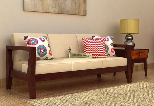 The Hugo 3 Seater Wooden Sofa in Mahogany Finish is perfect sofa for those who prefer to go with simple models. Shop wooden three seater sofa online to create beautiful seating arrangement in living room. Get 3 seater sofa online #Jaipur #Bhopal #Vadodara
