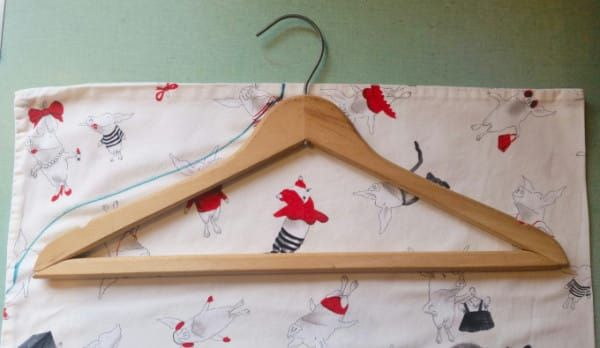 She Traces A Hanger Onto An Old Pillowcase. The Reason? SO Smart!