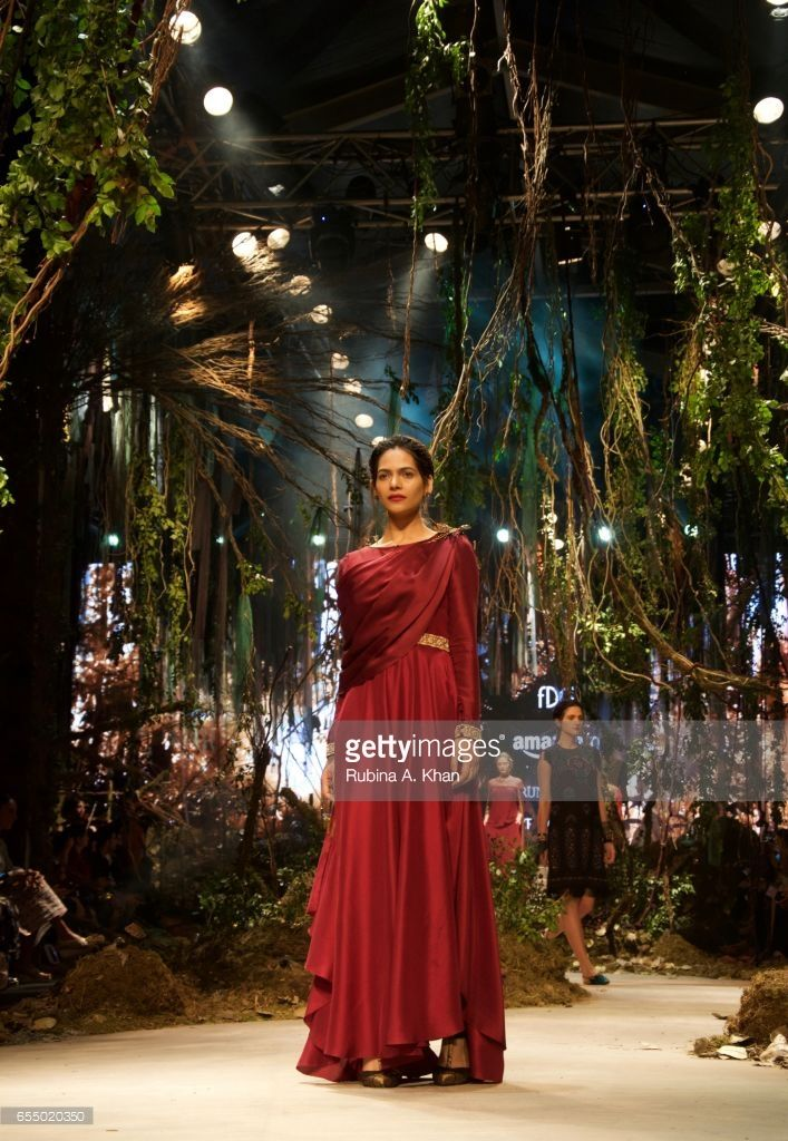 Tarun Tahiliani and Amit Aggarwal's collaborative ready-to-wear collection for the grand finale of the FDCI presented India Fashion Week Autumn/ Winter '17 at Jawaharlal Nehru Stadium on March 18, 2017 in New Delhi, India.