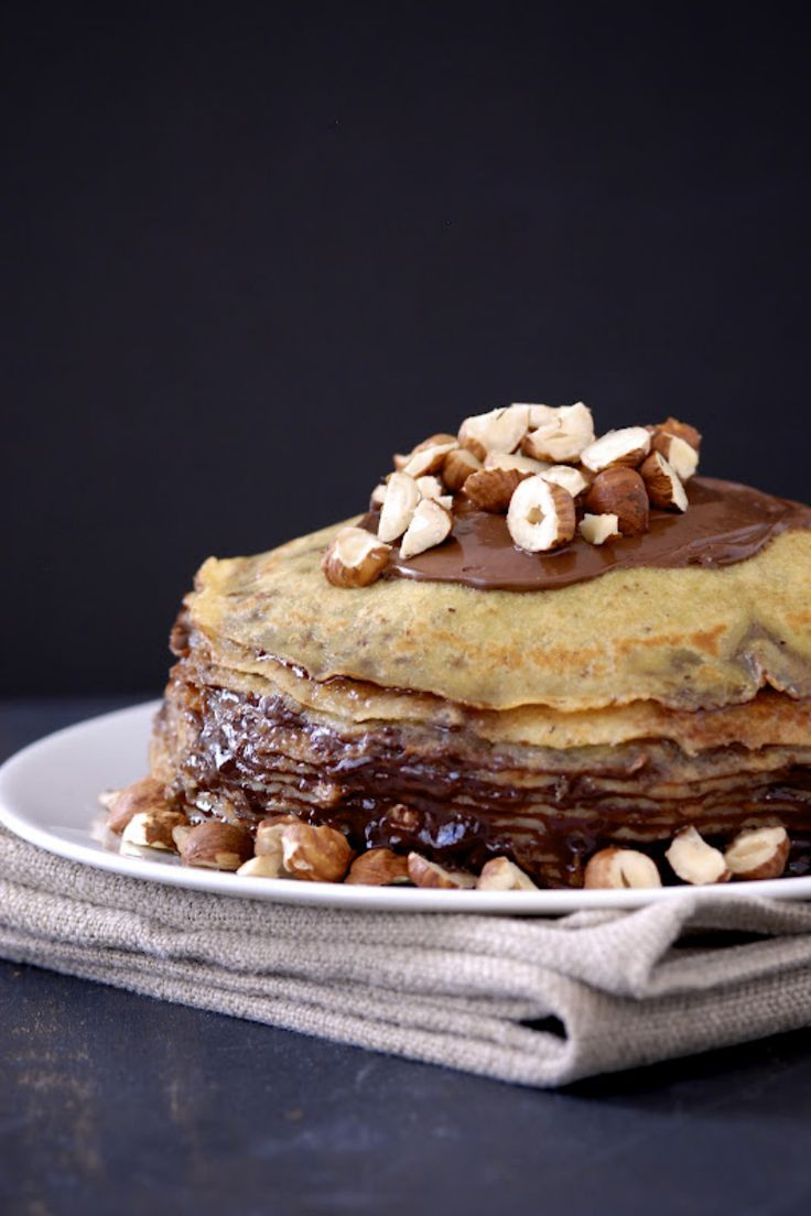 Hazelnut crepes are spread with Nutella and stacked sky-high to create this gluten-free cake.