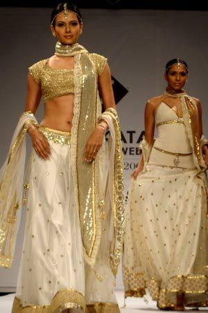 Ivory and gold :: love the simple skirt and blouse design with a detailed dupatta