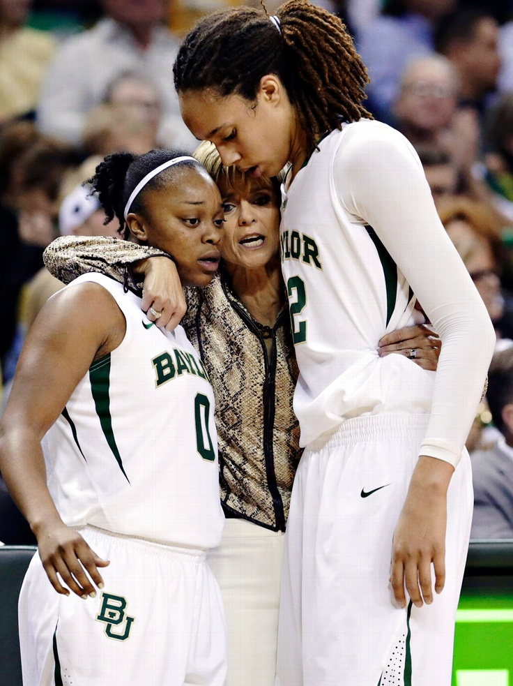 Brittney Griner and Odyssey Sims with coach Kim Mulkey