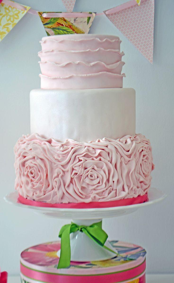 Pink ruffled rose wedding cake by bake Sale.