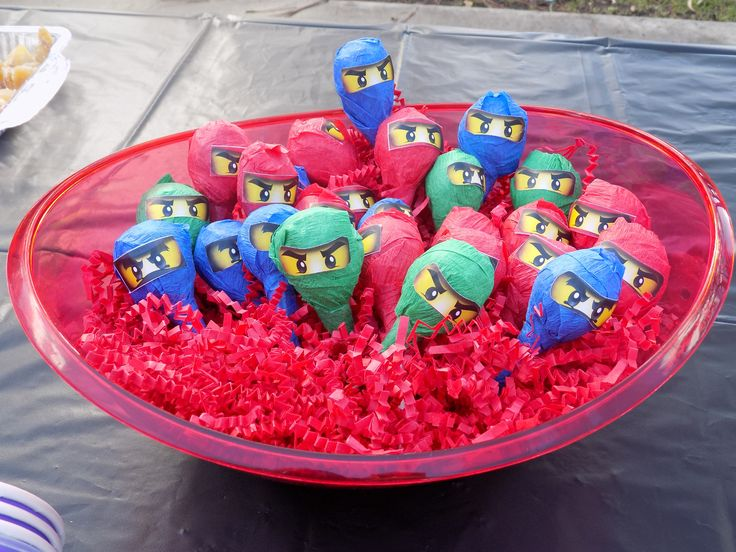 Ninja lollipops - tootsie roll pops wrapped in crepe paper and sticker eyes.  The printables I used were provided FREE (thank you!!) from Seshalyn's Party Ideas. http://seshalynspartyideas.com/ninjago-birthday-party-ideas-free-ninjago-party-printables/