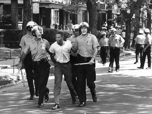 Police arrest a man on 12th Street in Detroit on July 1967 | Ref in