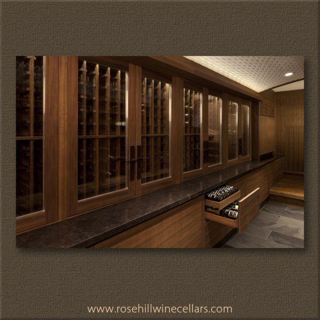 Stunning #wine cellar with walnut cabinets. #winestorage #wineroom