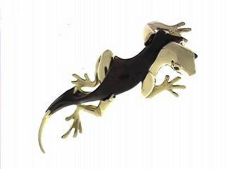 Black Onyx and yellow gold lizard pin by Mark Schneider