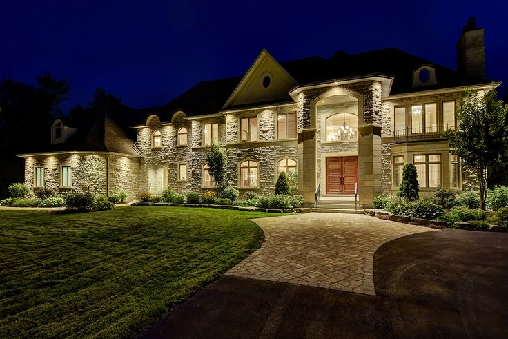 This magnificent home was designed by award winning Andre Godin where his expertise in combining design and function echo throughout the French Provincial style home. Uncompromising finishes and individually designed custom cabinets throughout. Artisan crafted iron hand railings. Top quality stainless steel appliances. Professionally landscaped, South-facing lot offering a walled terrace and stamped concrete patio.