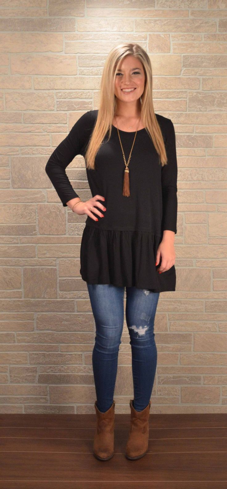 Perfect fall layering piece! This soft tunic top has a ruffle at the hip and is flattering on anyone. Thick knit so no need for a cami. This tunic also comes in taupe. 95% rayon, 5% spandex. Model is