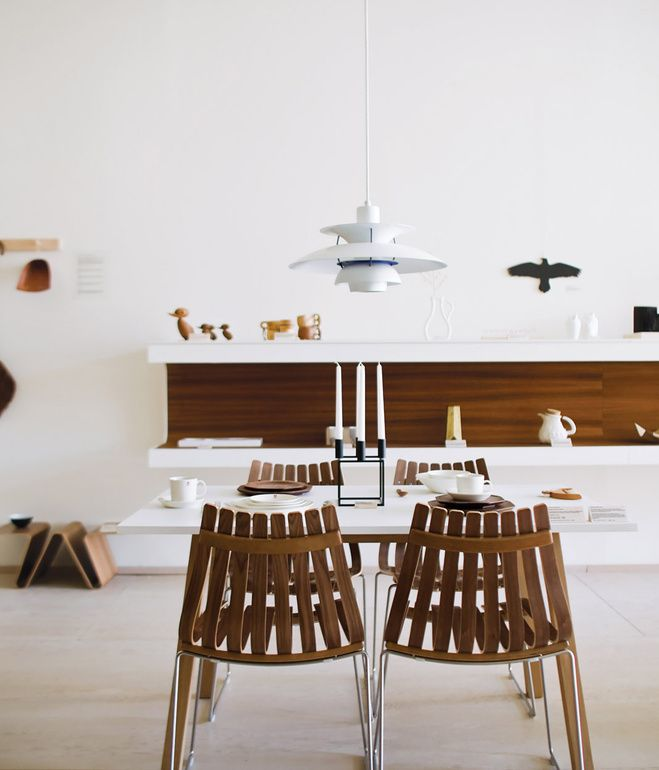 At the shop, Poul Henningsen's PH 5 lamp for Louis Poulsen hangs over the Sandra table by Thomas Sandell for Asplund and Scandia chairs b...
