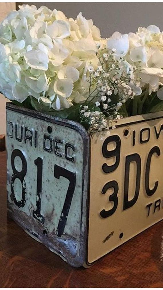 We have taken a few old, well loved license plates and repurposed them into some really cool boxes.  These boxes measure 6x 6x 6 square and come with a nice, heavy duty acrylic 5x 5x 5 vase/liner. We have fabricated a sturdy, galvanized bottom for the boxes and the sides are reinforced on the inside with galvanized brackets and pop rivets.  This listing is for the black and white tag seen in picture #1 and #2. We will have these available in several color combos, years and states, includ...