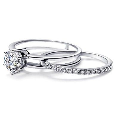 A very unique diamond bridal set, featuring unique sliding wedding band, that slides into the engagement ring to form a very exciting bridal set that would definitely sweep her of her feet at the very first sight. the wedding ring set is available on the sale price for limited time only. the order comes with free shipping