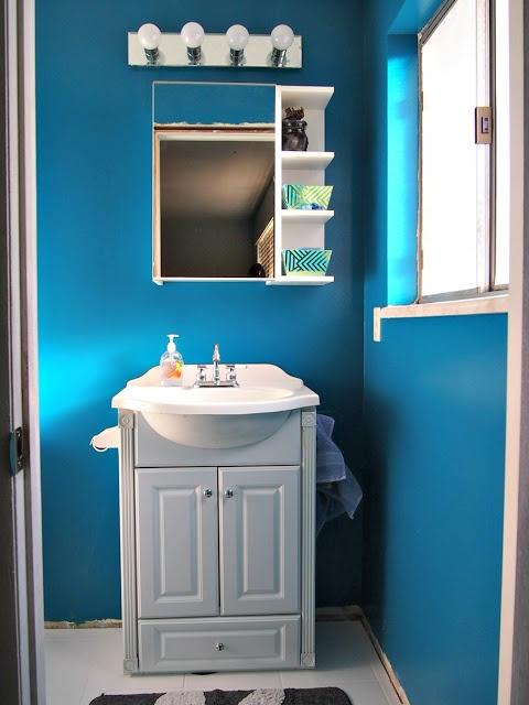 small master bath // peacock blue paint // ikea medicine cabinet // 3/4 bath