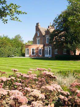 Rear Lawn: country Garden by Paul Dracott Garden Design