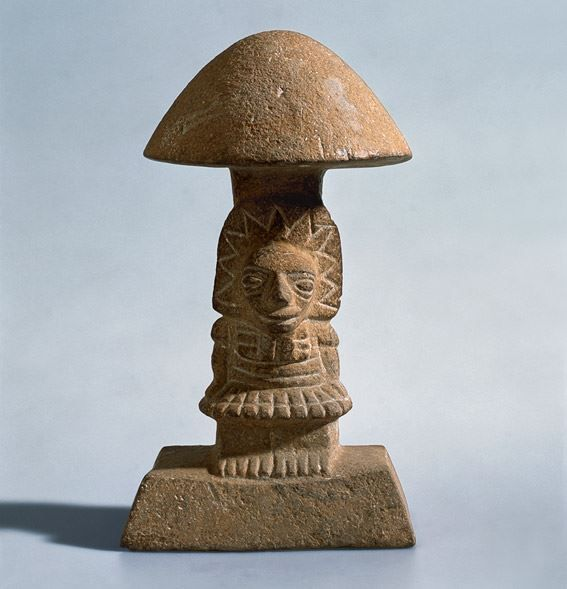 MUSHROOM STONE.  Taking psychoactive substances plays a vital role in the cultural history of Central and South America. The figure likely shows the formal merger of divine mushroom and an elite person. The figure was certainly at the heart of cultic acts, during which fungi were ingested in order to get in touch with the world of God. www.Rietberg.ch/ onlinesammlung Mesoamerica (El Salvador) 300 BC - 250 ad