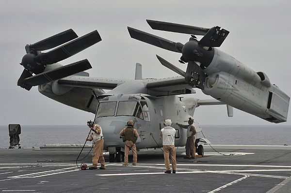 PACIFIC OCEAN(June 14, 2013)US Marines inspect an MV-22 Osprey tilt-rotor aircraft after landing on the Japan Maritime Self-Defense Force helicopter destroyer JS Hyuga (DDH 181) during amphibious exercise Dawn Blitz. Dawn Blitz is a scenario-driven exercise led by the U.S. 3rd Fleet and 1 Marine Expeditionary Force that will test participants in the planning and execution of amphibious operations through a series of live training events.(USN photo by Mass Comm Specialist Seaman Molly A…