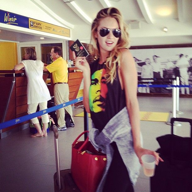 SBH ~ Candice Swanepoel ~ Rose'and passport in hand, on my way back to NYC. Thank you #stbarts until next year.