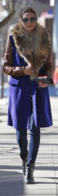 Olivia Palermom in a Diane von Furstenberg purple coat and Isabel Marant black ankle boots.
