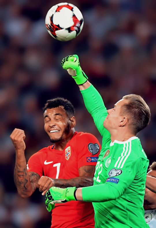 """Marc-Andre ter Stegen fights for the ball with Joshua King of Norway during the FIFA 2018 World Cup Qualifier between Germany and Norway at Mercedes-Benz Arena on September 4, 2017 in Stuttgart, Baden-Wuerttemberg. """