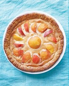 With a sunny arrangement of peak peaches, this dessert is summer in a pie plate. Make a ring of foil to protect the crust from browning too quickly: Cut a piece twice the size of the pie, fold it in half, and cut a circle out of the center large enough to expose the top but cover the edges.