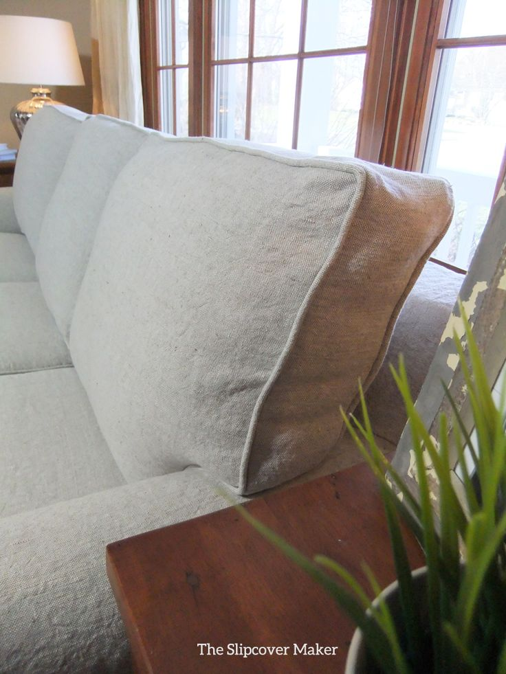 Washed, heavy weight linen slipcover in color Oatmeal made for an old sleeper sofa. It looks new now!