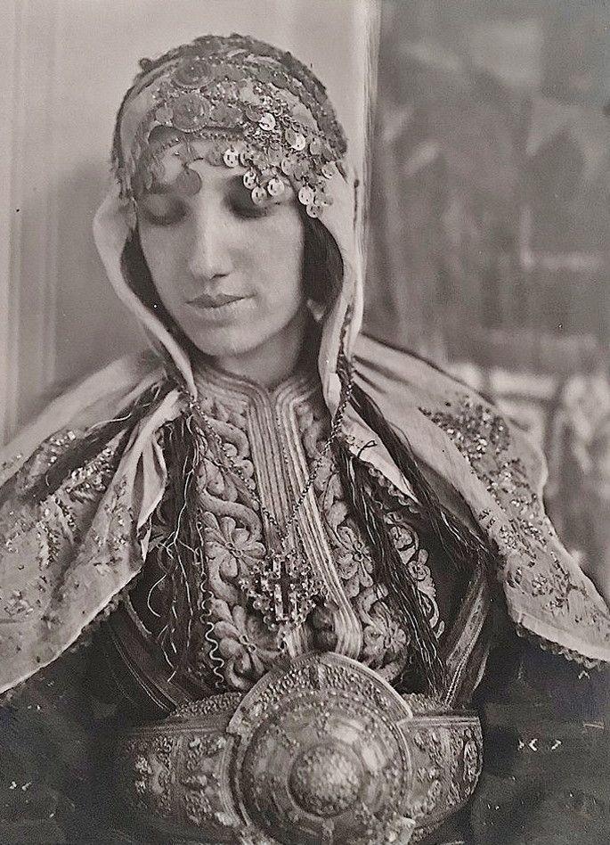 A Macedonian woman in traditional bridal costume, early 20th century. Christian, late-Ottoman style. (Source: Tesori Orientali).