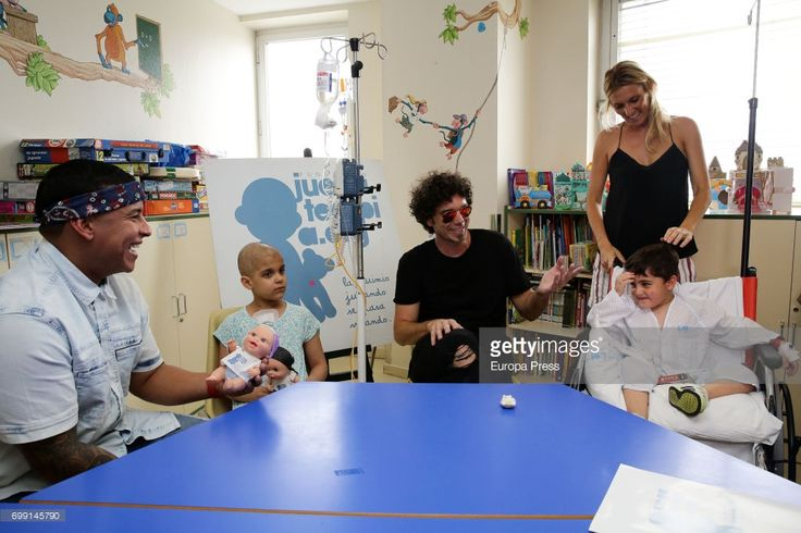 Daddy Yankee (L), Pablo Ibañez (3L) and Monica Esteban visit chidren at Childhood Oncology area at La Paz Hospital organized by the Juegaterapia Foundation that fight against childhood cancer on June 19, 2017 in Madrid, Spain.