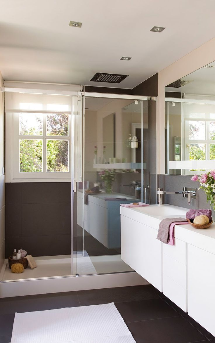 Easy way to modernize: large slat tile, floating vanity & glass shower