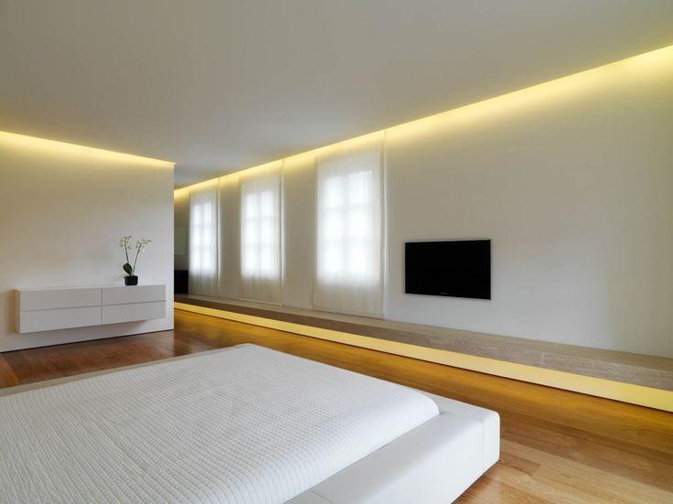 Subtle, indirect lighting emphasizing the long horizontal lines inside the Soldati House by Victor Vasilev.