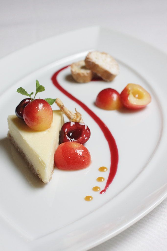 Chevre Cheesecake with poached cherries and cherry coulis