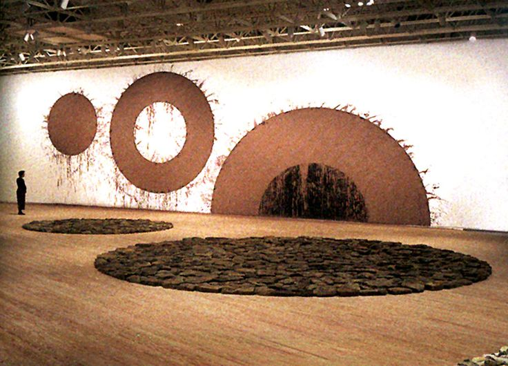 FROM ONE TO ANOTHER Richard Long Mud circles and floor sculpture