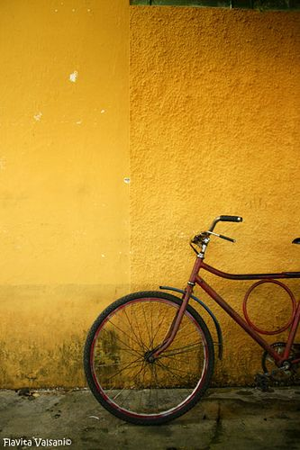 yellow wall and bicycle